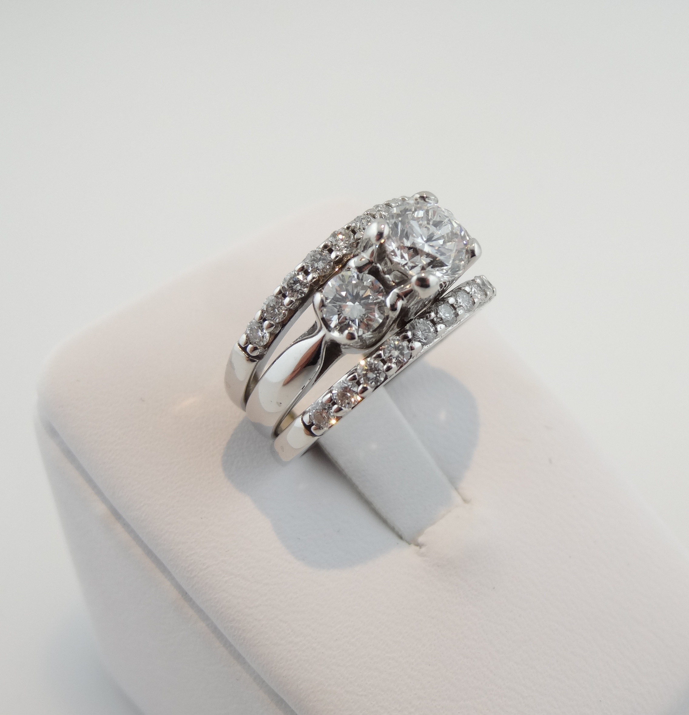 3 stone Diamond ring with diamond wedding bands on each side 165TCW